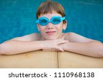 young boy in the swimming pool. | Shutterstock . vector #1110968138