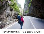 smiling feamle tourist walking... | Shutterstock . vector #1110974726