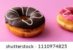 pair of black and pink donuts... | Shutterstock . vector #1110974825