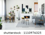 black chairs at dining table in ... | Shutterstock . vector #1110976325