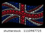 waving british state flag on a... | Shutterstock .eps vector #1110987725