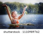 Little Girl Smiling Playing In...