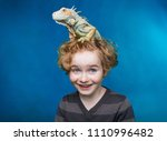 boy and iguana   child and his ...