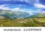 panorama of the alps in summer. ... | Shutterstock . vector #1110999845
