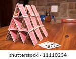 House Of Cards On A Wooden...