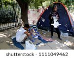 refugees and migrants in a... | Shutterstock . vector #1111049462