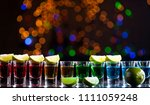 alcoholic drink into small... | Shutterstock . vector #1111059248