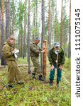 forestry inspector with a group ... | Shutterstock . vector #1111075145