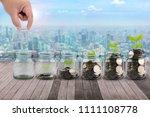male hand putting money coins...   Shutterstock . vector #1111108778