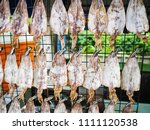 dried squids  traditional one... | Shutterstock . vector #1111120538