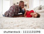 father tickling son as they... | Shutterstock . vector #1111131098