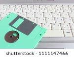 floppy disk and laptop | Shutterstock . vector #1111147466