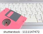 floppy disk and laptop | Shutterstock . vector #1111147472