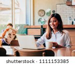asain woman working with laptop ... | Shutterstock . vector #1111153385