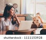 asain woman working with laptop ...   Shutterstock . vector #1111153928