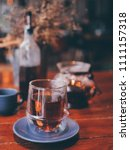 close up a cup of tea on wooden ... | Shutterstock . vector #1111157318