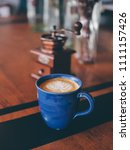 close up coffee on table in... | Shutterstock . vector #1111157426