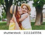 attractive woman in yellow... | Shutterstock . vector #1111165556