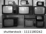 shelf near wooden wall with... | Shutterstock . vector #1111180262