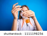 girl in a medical suit holds a ... | Shutterstock . vector #1111198256