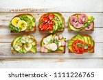 avocado sandwiches  toasts with ... | Shutterstock . vector #1111226765