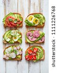 avocado sandwiches  toasts with ... | Shutterstock . vector #1111226768