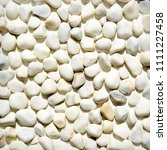 white pebbles background.... | Shutterstock . vector #1111227458