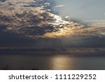 sky  sunbeams and water... | Shutterstock . vector #1111229252