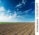 Agriculture Plowed Field And...