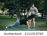 personal trainer correcting his ... | Shutterstock . vector #1111313765