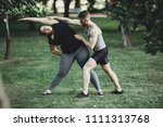 personal trainer correct his... | Shutterstock . vector #1111313768