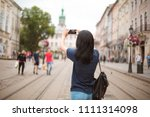 tourist with backpack walking... | Shutterstock . vector #1111314098