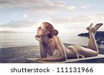 beautiful  young woman lying on ... | Shutterstock . vector #111131966