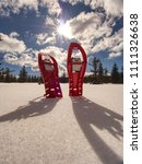 set of red snowshoes. snowshoes ... | Shutterstock . vector #1111326638