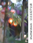lighted lanterns through the... | Shutterstock . vector #1111327118