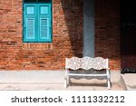 white bench with vintage brick...   Shutterstock . vector #1111332212