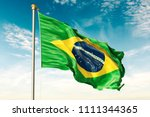 brazil flag on the blue sky... | Shutterstock . vector #1111344365