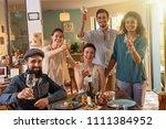 multi ethnic group of friends... | Shutterstock . vector #1111384952