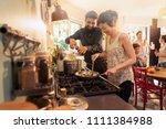 mixed group of friends having... | Shutterstock . vector #1111384988