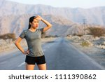 tired runner taking a rest on a ... | Shutterstock . vector #1111390862