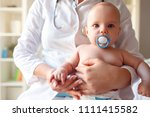 baby with pacifier in mouth at... | Shutterstock . vector #1111415582