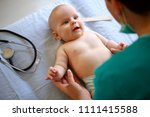 sweet baby on pediatric checkup | Shutterstock . vector #1111415588