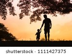 father son holding hands... | Shutterstock . vector #1111427375