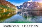 sunny morning on the lake... | Shutterstock . vector #1111444622
