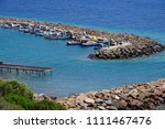small fishing boats anchored in ... | Shutterstock . vector #1111467476