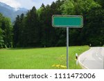 Small photo of Green sing on pole for text and word, sings on the road
