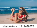 young woman in red bikini with... | Shutterstock . vector #1111478672