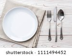 empty plate spoon fork and... | Shutterstock . vector #1111494452