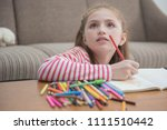 little girl looking up while... | Shutterstock . vector #1111510442