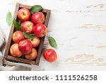 Ripe Red Apples On Wooden Table....